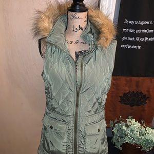 Green vest with fur hood